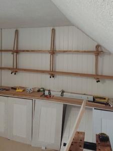 Hanging shelves in loft bedroom